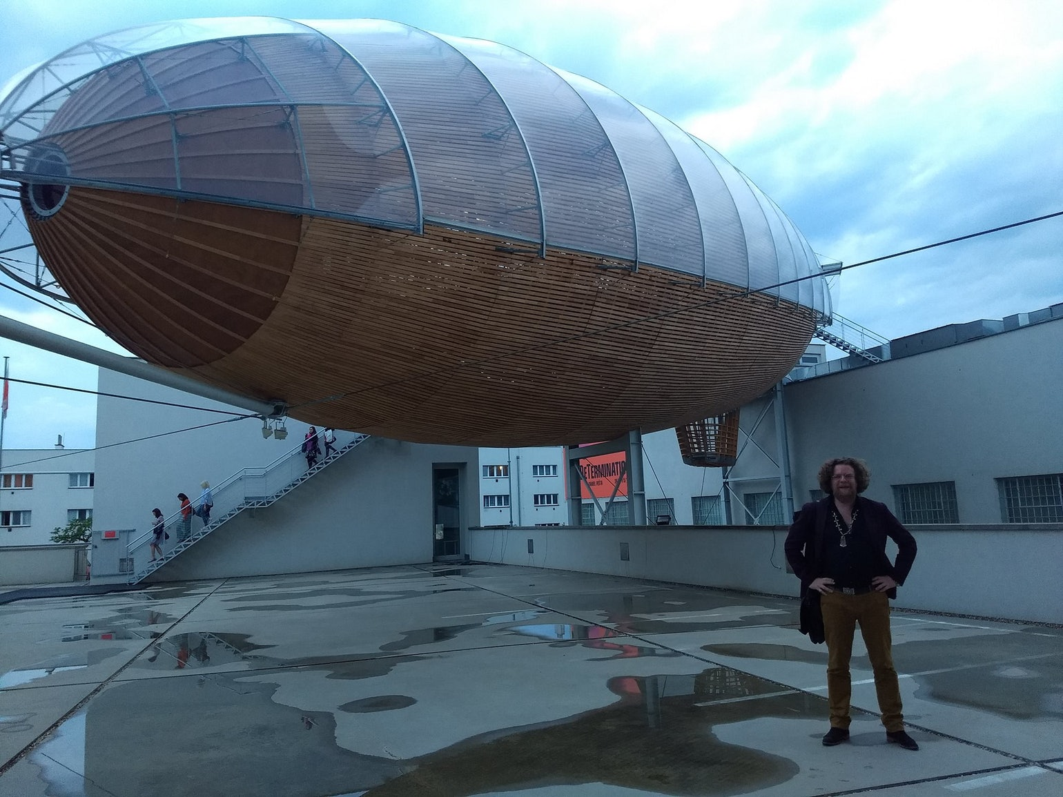 The author of 'WILL' in front of the airship-shaped reading room of the DOX Centre. Photo © Jeroen Olyslaegers