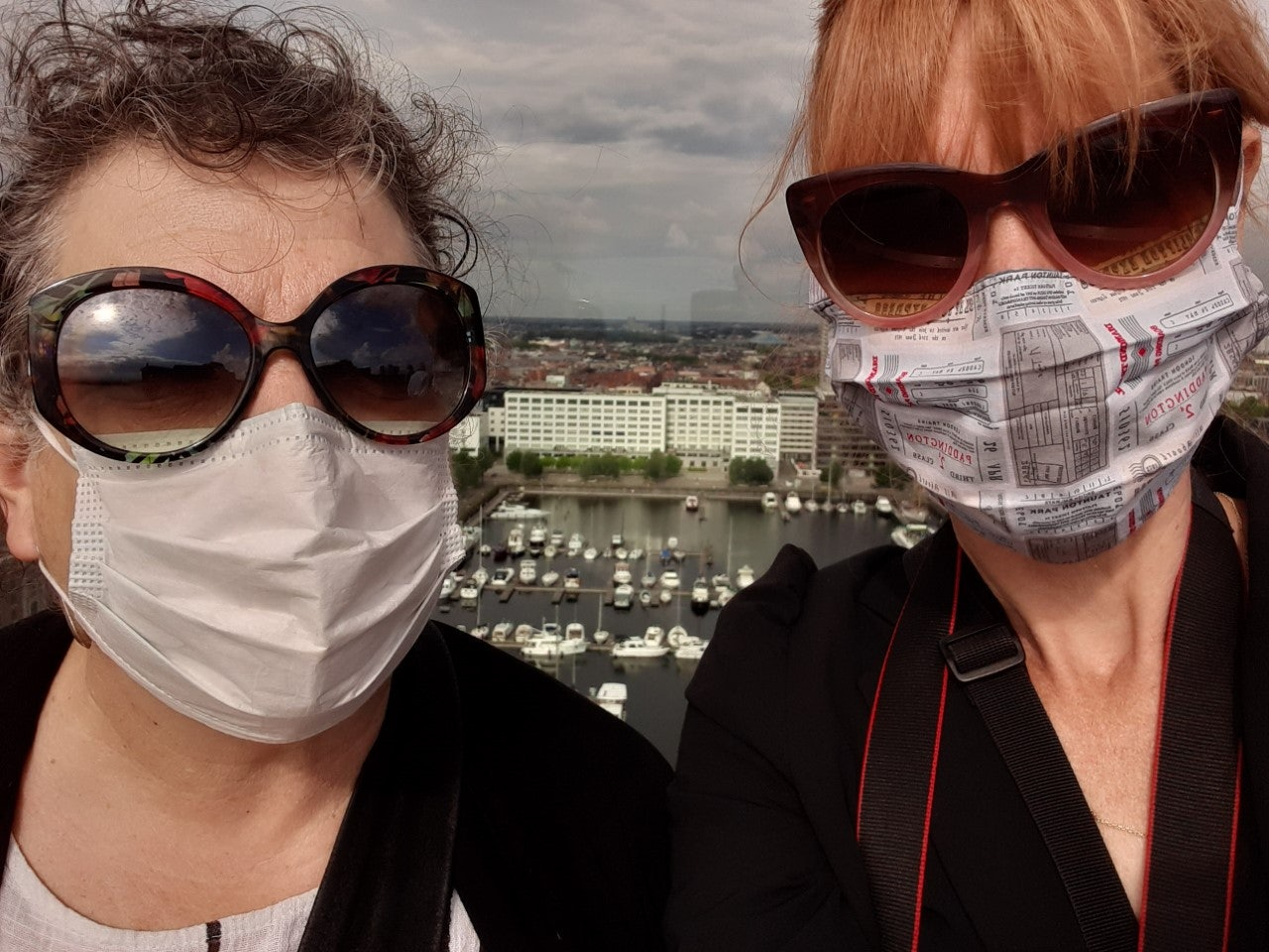 Masked translators Laura Vroomen and Lorraine T. Miller