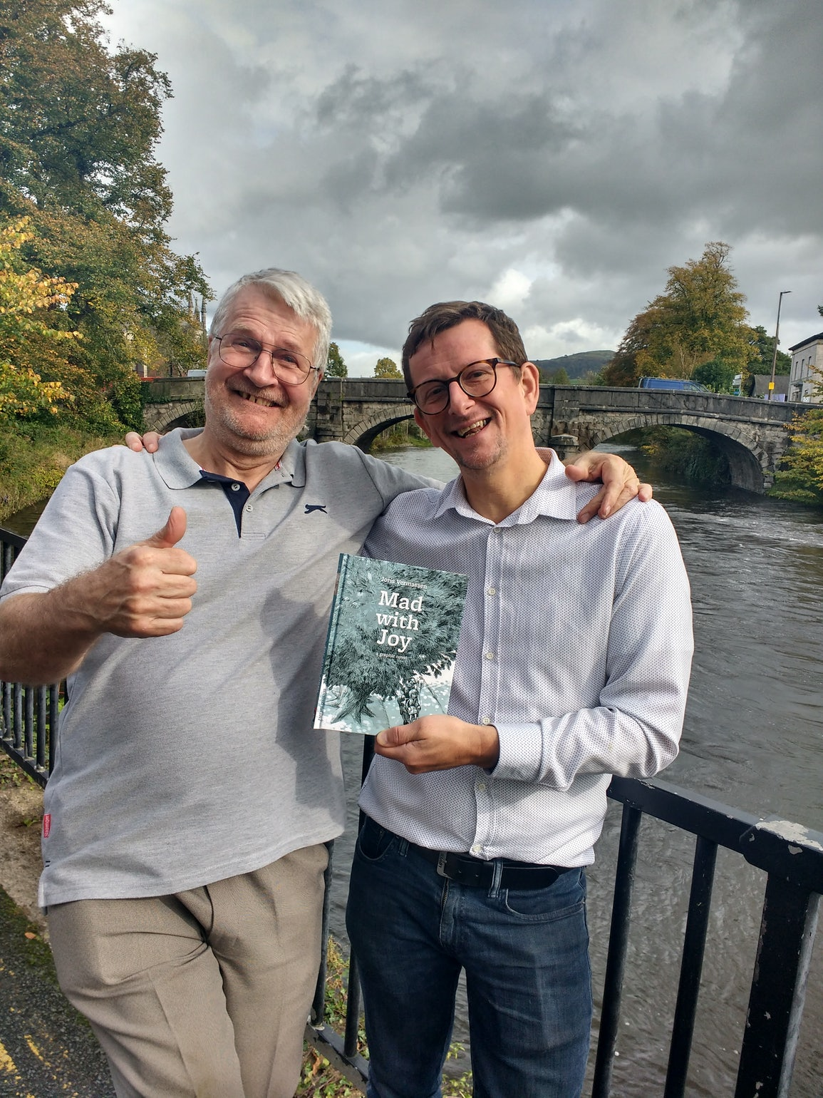 Joris Vermassen and his British publisher Stephen Robson with the English edition of 'Mad with Joy'